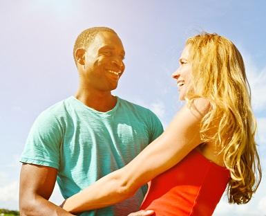 Happy Mixed Couple enjoying summertime