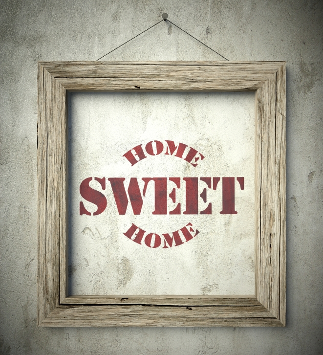 Home sweet home emblem in old wooden frame