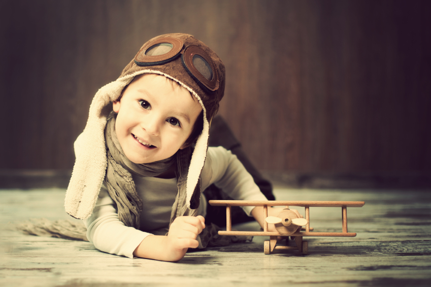 Young boy, playing with airplane