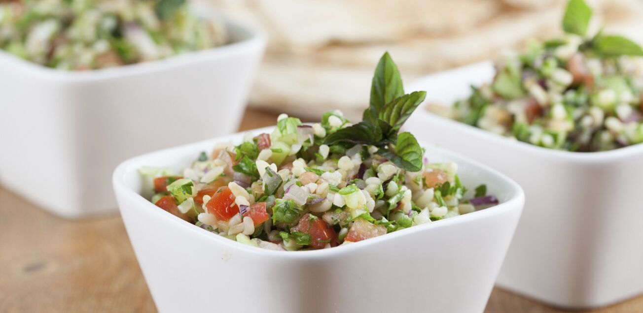 Gourmet Middle Eastern salad Tabbouleh in white bowls