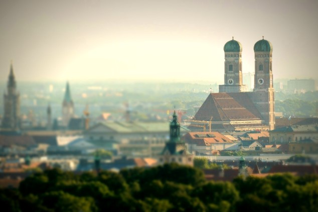 A panoramic view of Munich's inner city, focusing on the towers of the famous Frauenkirche