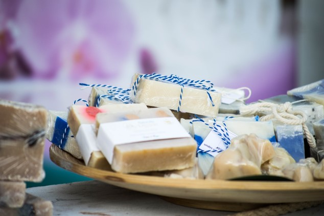 A close-up of several handmade soap bars on a plate